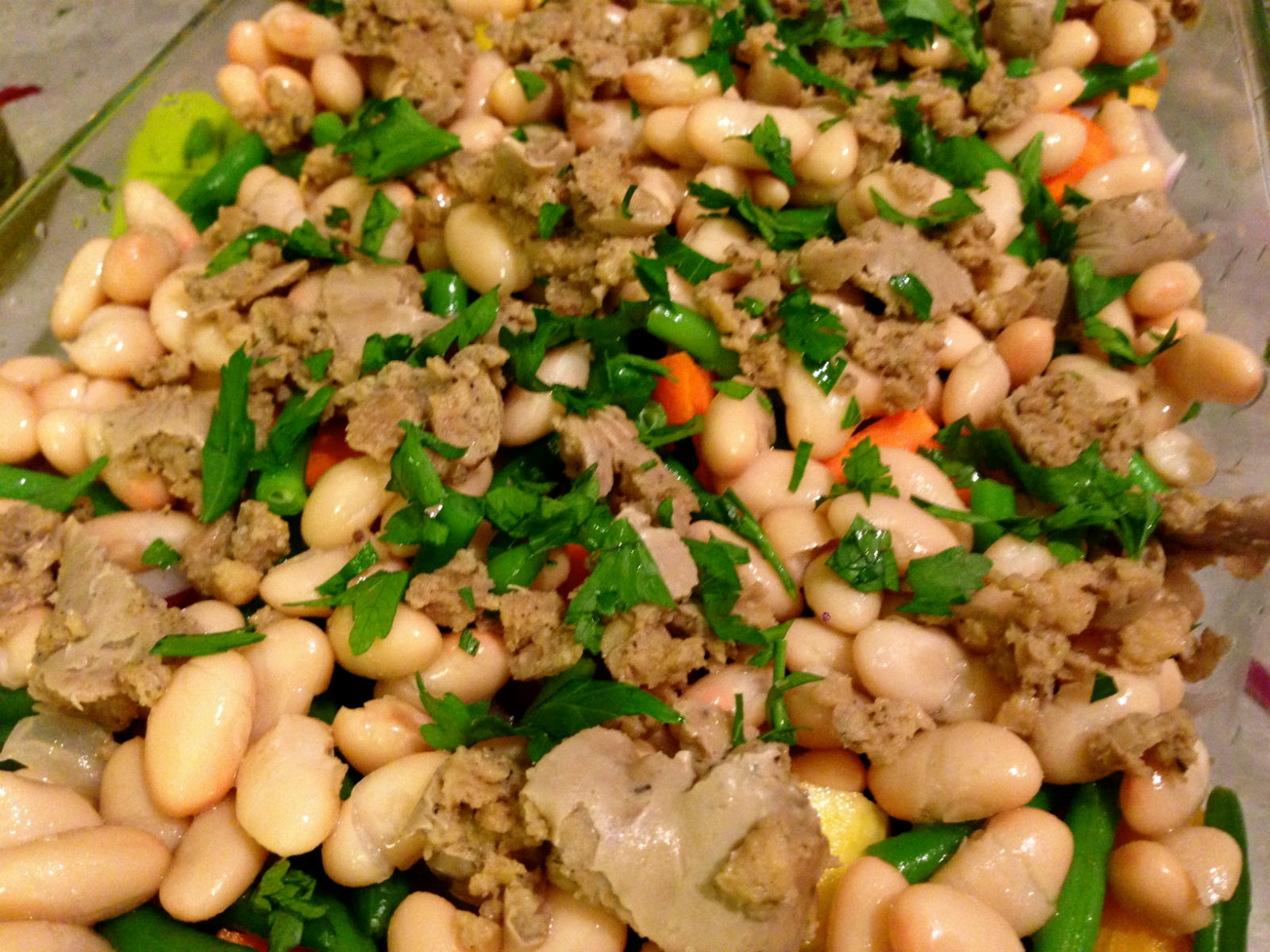 "Scatter ""meat"" and sprinkle fresh parsley over arranged vegetables"